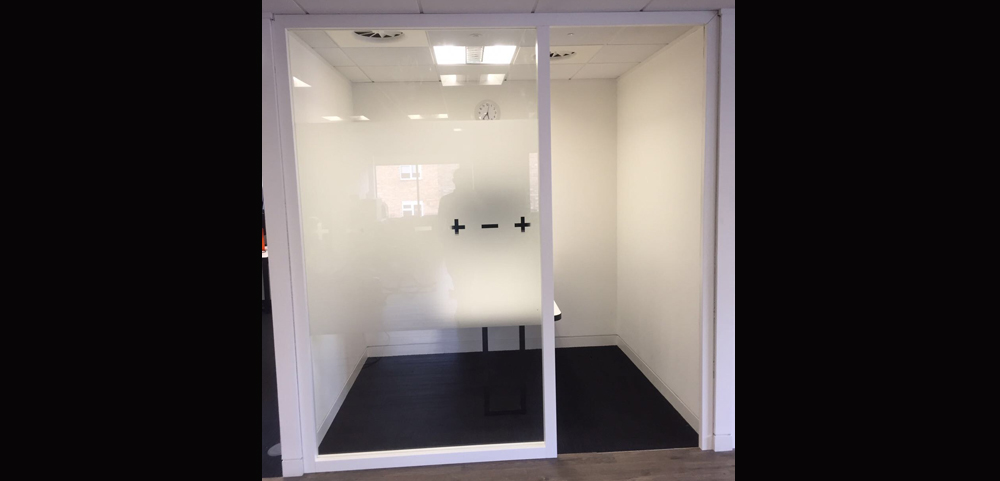 glass partition with wooden frame