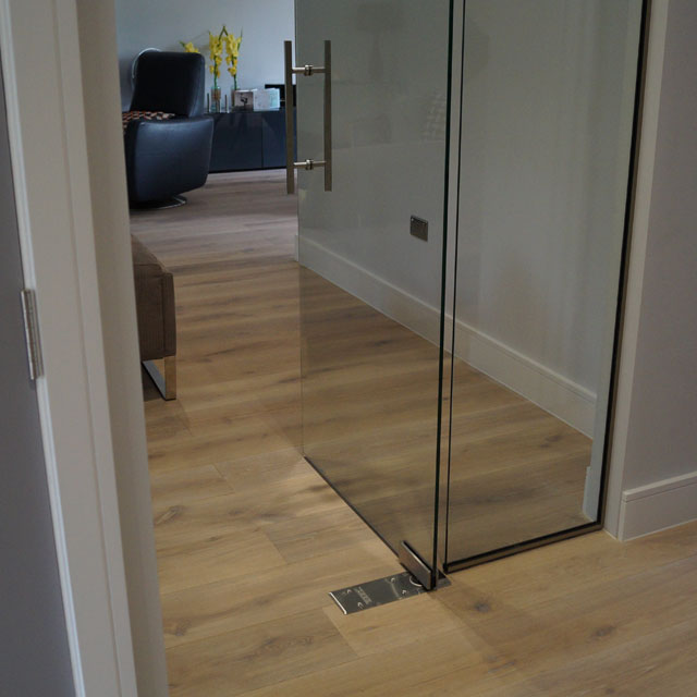 Clear glass door with pivot hinge fitted project