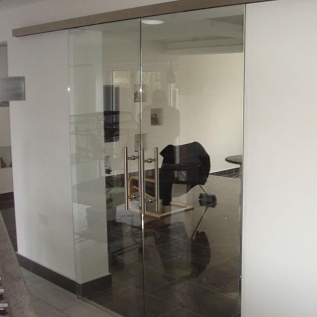 Clear glass double sliding doors