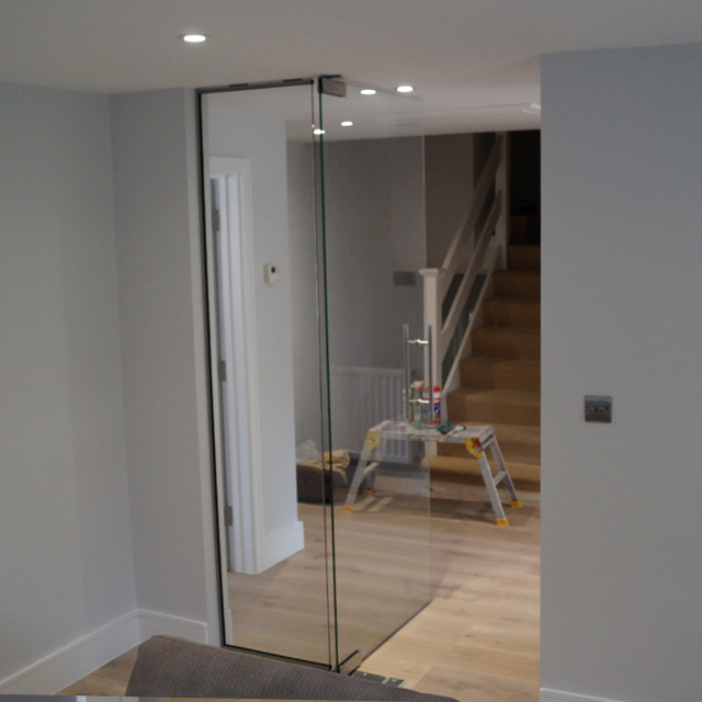 Clear glass pivot door with side panel fitted project