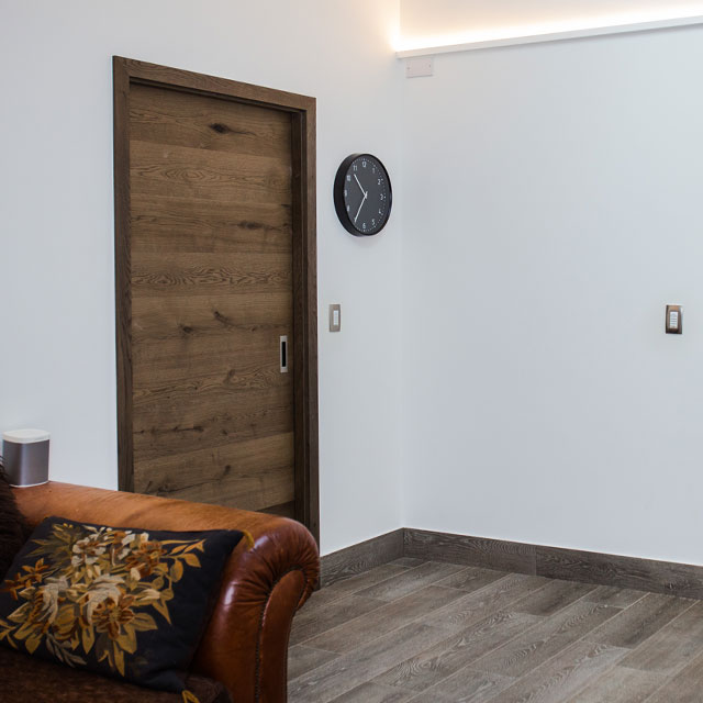 hidden sliding door wood veneer surface