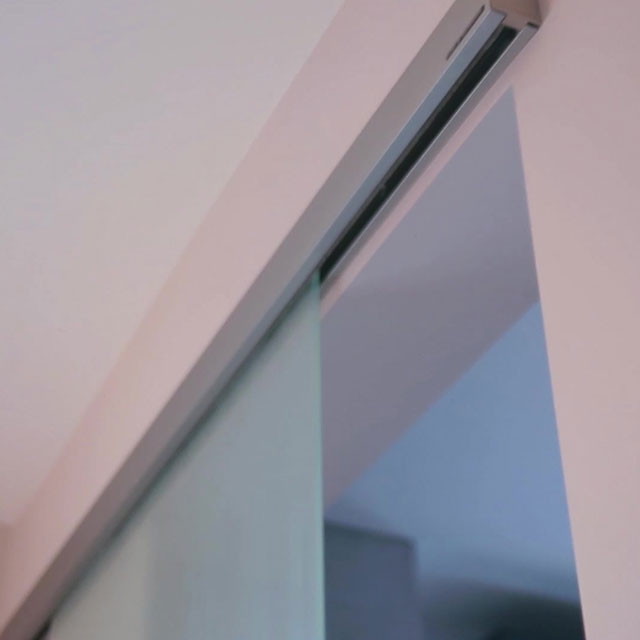 sliding system for internal glass doors